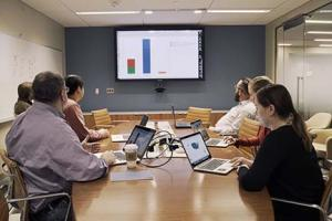 Photo of a group using the DSL conference room.