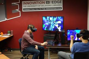 Two students interacting with a virtual reality computer system