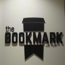 A photo of the bookmark cafe logo