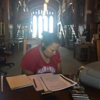 Photo of Marla Nauni in the Western History Collections Reading Room; Image credit Juanita Pahdopony